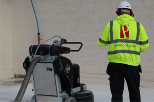 Grinding the terrazzo floor with a remote control grinder