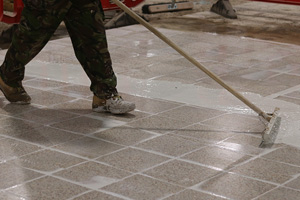 Video of operative flood grouting patches of tiles