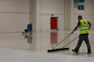 Applying a sealer to the terrazzo floor