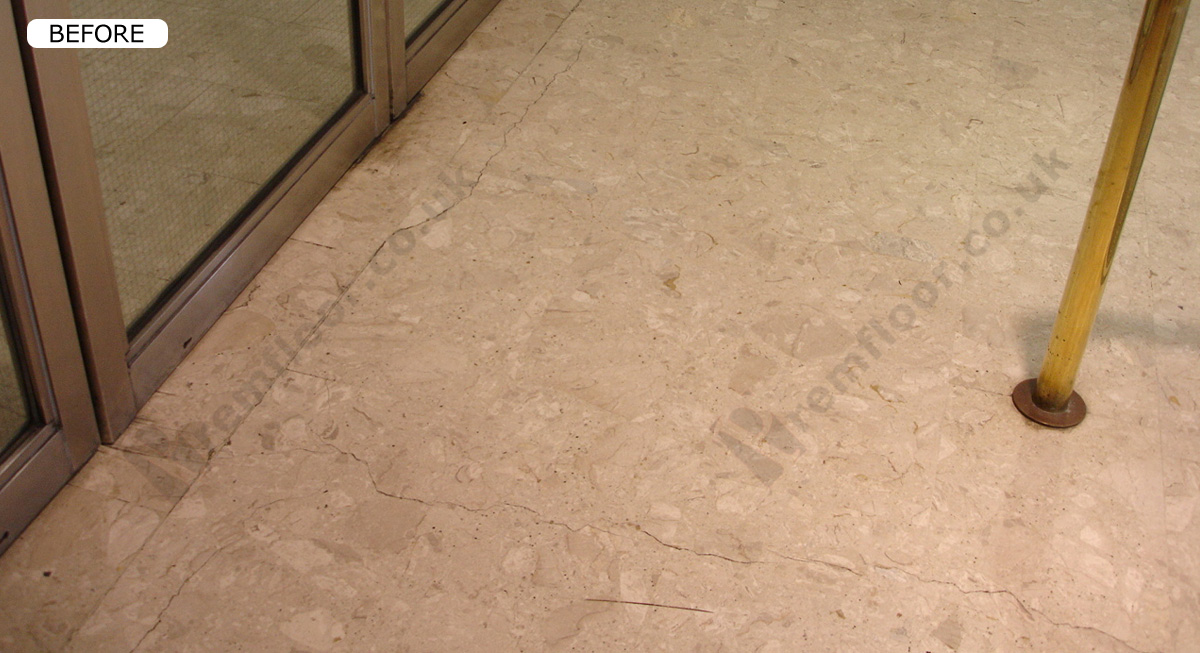 Cracked marble floor slabs in entrance foyer of house of fraser
