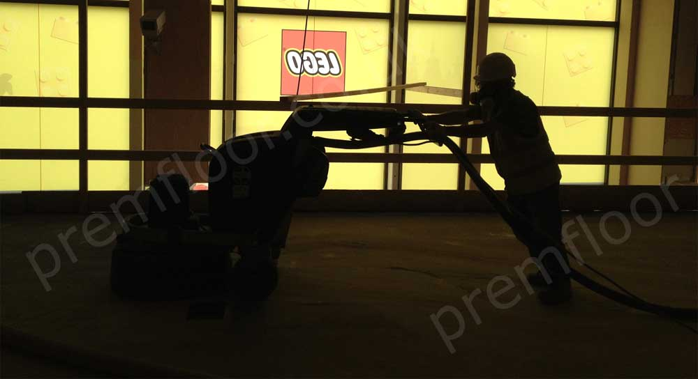 Silhouette of man grinding floor in LEGO® Store