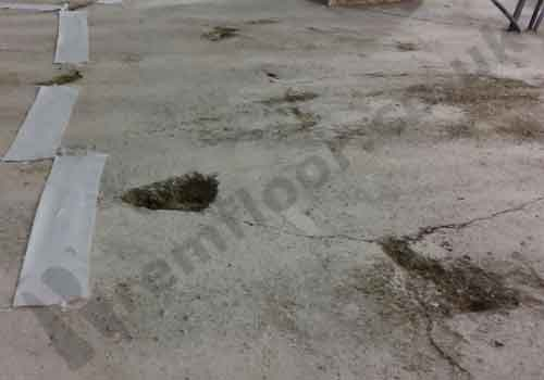 Damaged sand/cement screed in need of repair