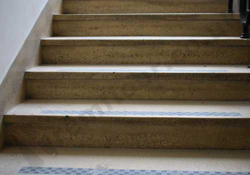 Dirty and stained terrazzo staircase
