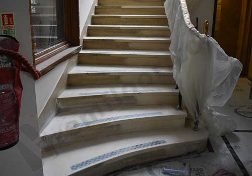 Abrasivley cleaning terrazzo staircase
