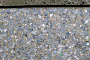 Aggregate used in castle cement terrazzo floor with grey chippings and a concrete intergace