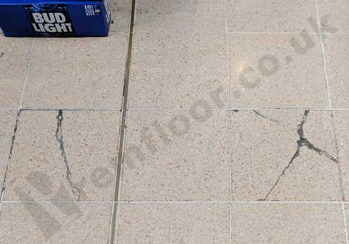 damaged terrazzo tiles - cracked and joints failing