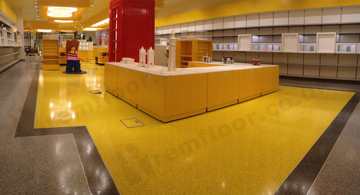 Large retail store featuring 3 colours of resin terrazzo seperated by aluminium strips