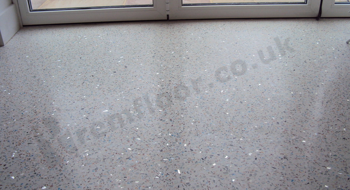 finely polished floor off white coloured epoxy resin terrazzo including mirror glass, blue glass and mother of pearl aggregate