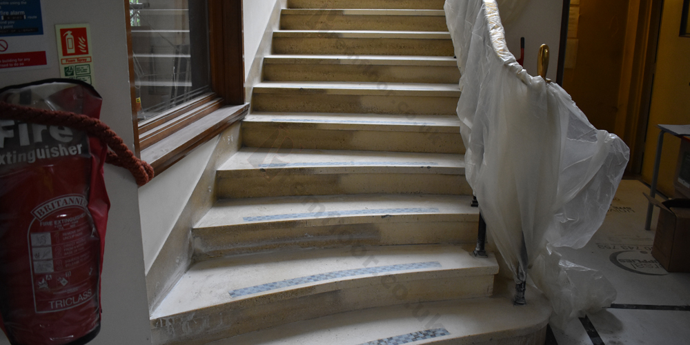 Before and after picture of a terrazzo staircase restoration