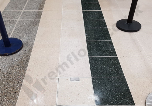 Polished terrazzo tiles and freshly installed floor box