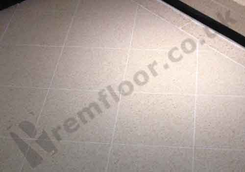 Clean repaired joints in a shopping centre terrazzo tile floor