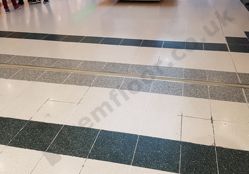 Shopping centre terrazzo floor prior to removal and installation of electricity underneath