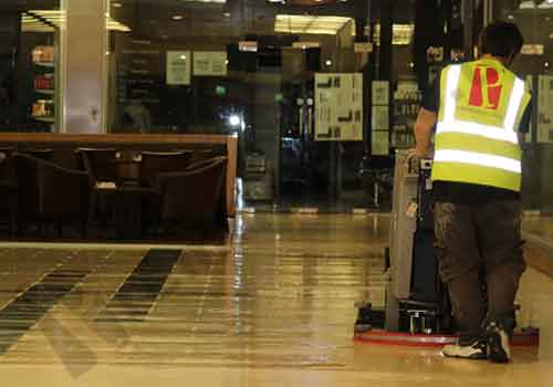 Premfloor operative pushing a scrubber diamond polishing the terrazzo floor in a shopping centre