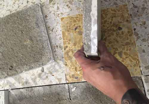 Replacing terrazzo tiles in a shopping centre