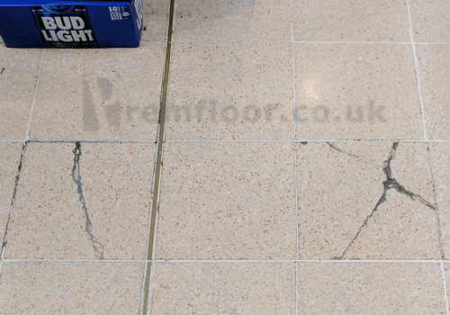 2nr damaged (cracked) terrazzo floor tiles in supermarket