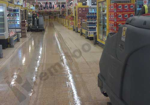 Two nilfisk scrubber dryers diamond polishing a terrazzo floor in supermarket