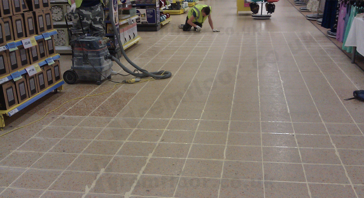 Joints between terrazzo tiles cut and filled in a supermarket