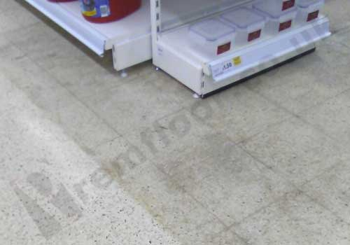 heavy staining revealed on terrazzo floor during movement of shelves on shop floor