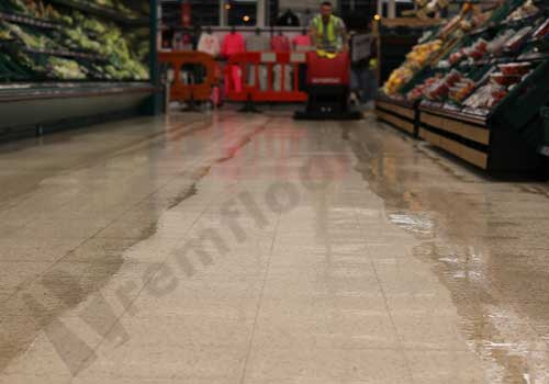 Produce aisle in supermarket during terrazzo diamond polishing process