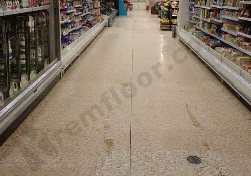 Supermarket aisle after diamond polish with scrubber dryer
