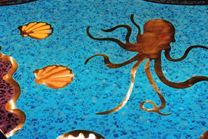 Octopus and shells in an ocean themed terrazzo bar counter top