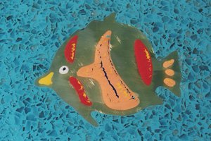 Fish cut from brass in a resin terrazzo bar themed underwater