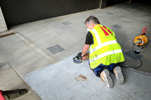 Refurbishing a shop entrance terrazzo floor with angle grinder