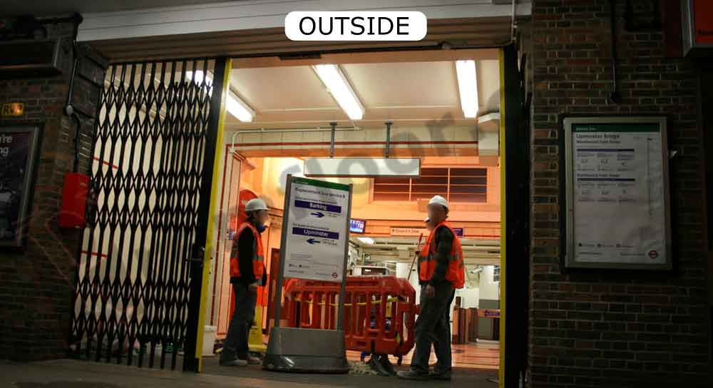 Operatives standing in doorway during night shift at upminster bridge station