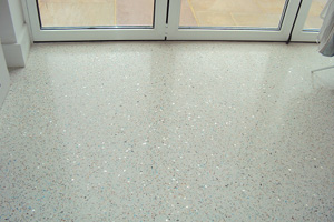 Mother of Pearl, Mirror Glass and Blue Glass resin terrazzo floor in front of window